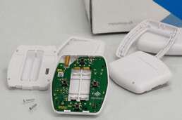 Injection molded plastic part with electronics for an IoT button